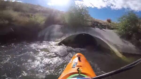 Kayaking Through a Drain Pipe - Sputnik International