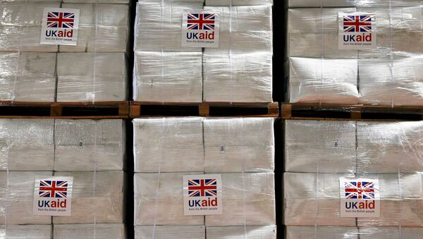 Boxes containing kitchen sets are stored at a UK Aid Disaster Response Centre where humanitarian supplies are being collected to be airlifted to Iraq at Cotswold Airport near the village of Kemble, Gloucestershire, southern England on August 14, 2014. - Sputnik International