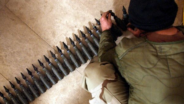 US Army Spcl. Eli Butcher of Charlie Company, from the 1-22 Battalion, 4th Infantry Division, counts 25mm rounds of depleted uranium ammunition, 11 February, 2004, at his base in Tikrit, 180 km (110 miles) north of Baghdad - Sputnik International