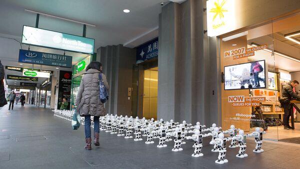 Dancing Robots Queue For New iPhone - Sputnik International
