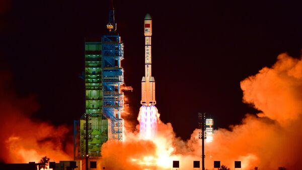 China's Tiangong 2 space lab is launched on a Long March-2F rocket from the Jiuquan Satellite Launch Center in the Gobi Desert, in China's Gansu province - Sputnik International