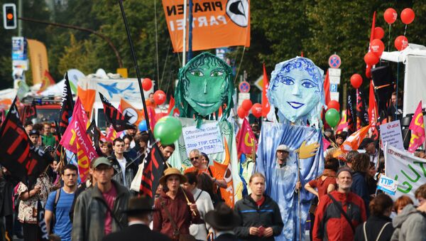 Rights activists take part in a march to protest against the Transatlantic Trade and Investment Partnership (TTIP) and Comprehensive Economic and Trade Agreement (CETA) in Berlin, Germany - Sputnik International