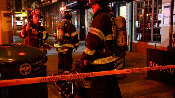 New York City firefighters stand near the site of an explosion in the Chelsea neighborhood of Manhattan, New York, U.S. September 18, 2016. - Sputnik International