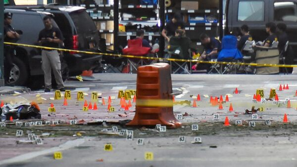 Evidence markers on the street surround police and Federal Bureau of Investigation (FBI) officials near the site of an explosion in the Chelsea neighborhood of Manhattan, New York, U.S. September 18, 2016. - Sputnik International
