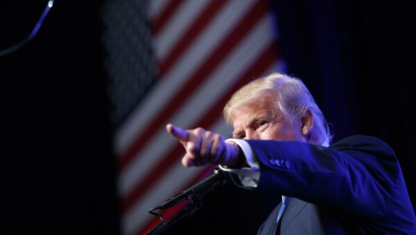 In this Sept. 16, 2016, photo, Republican presidential candidate Donald Trump speaks during a campaign rally at the James L. Knight Center in Miami. - Sputnik International