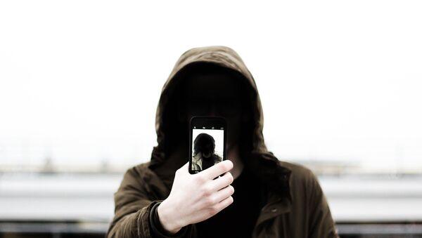 Mobile phone user - Sputnik International