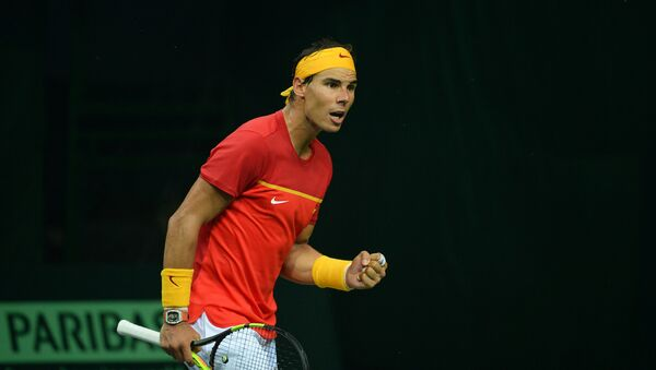 Spain's Rafael Nadal celebrates a point during his doubles tennis match with teammate Feliciano Lopez against India's Leander Peas and Saketh Myneni at the Davis Cup World Group tennis playoffs between Spain and India in New Delhi - Sputnik International