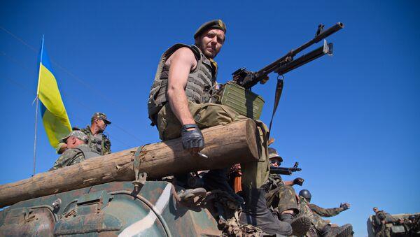 Ukrainian servicemen sit on an Armoured Personal Carrier (APC) as the column of Ukrainian forces passes near Artemivsk in the Donetsk region on June 9, 2015 - Sputnik International
