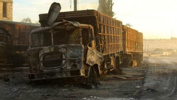 Damaged aid trucks are pictured after an airstrike on the rebel held Urm al-Kubra town, western Aleppo city, Syria September 20, 2016 - Sputnik International