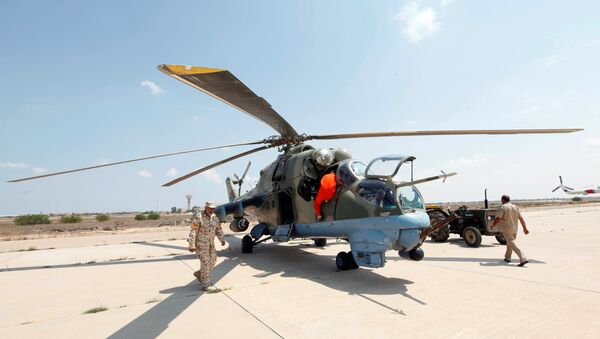 Members of Libyan forces allied with the UN-backed government prepare a renovated Libyan helicopter at Misurata air base, Libya September 4, 2016 - Sputnik International