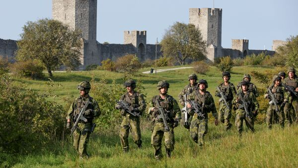 A squad from Skaraborg Armoured Regiment, currently training on the island of Gotland in the Baltic, patrols outside Visby's 13th century city wall, Sweden September 14, 2016 - Sputnik International