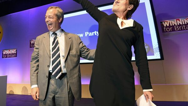 Nigel Farage (L), the outgoing leader of the United Kingdom Independence Party (UKIP), congratulates new leader Diane James, at the party's annual conference in Bournemouth, Britain, September 16, 2016. - Sputnik International
