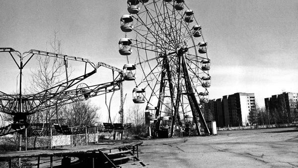 A picture dated 26 April 1996 for the 10th anniversary of the Chernobyl disaster, showing the ghost city of Pripyat. This attractions park has been once local children's favourite place of rest.  - Sputnik International