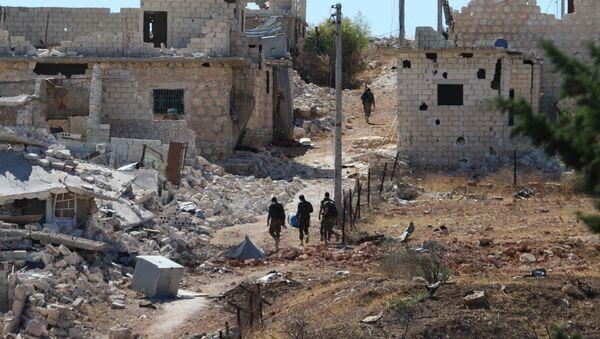 Syrian government forces walk amidst debris in the largely deserted Palestinian refugee camp of Handarat, north of Aleppo, on September 24, 2016 - Sputnik International