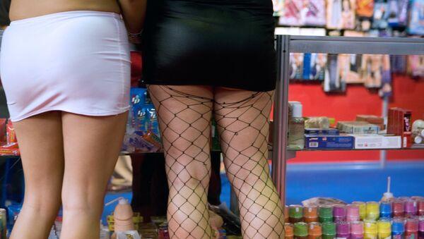 Two women buy sex toys at a shop - Sputnik International