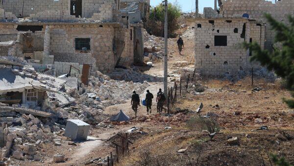 Syrian government forces walk amidst debris in the largely deserted Palestinian refugee camp of Handarat, north of Aleppo. (File) - Sputnik International