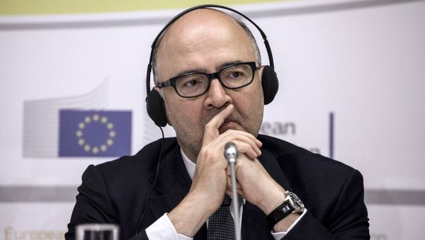 European Commissioner for Economic and Financial Affairs Pierre Moscovici listens to Greece's Finance Minister Euclid Tsakalotos (Unseen) during joint statements to the press at the EU representation office in Athens on July 18, 2016. - Sputnik International