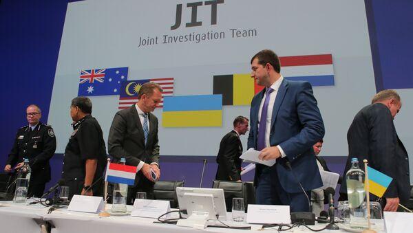 Presentation of a report in Nieuwegein on the investigation results of Malaysia Airlines Boeing 777 (flight MH17) crash in eastern Ukraine in 2014. First Deputy Prosecutor General of Ukraine Dmytro Storozhuk, second right - Sputnik International