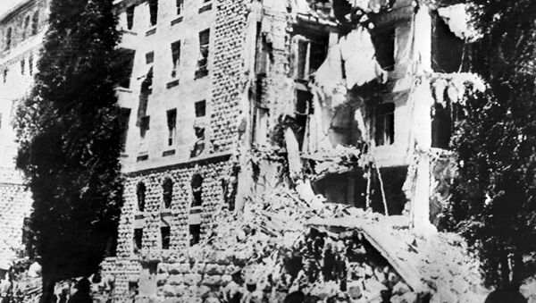 A picture taken 22 July 1946 shows the King David Hotel in Jerusalem, which housed the British Headquarters, damaged after a bombing attack against the British government by members of Irgun, a Zionist terrorist group headed by Menachem Begin. - Sputnik International
