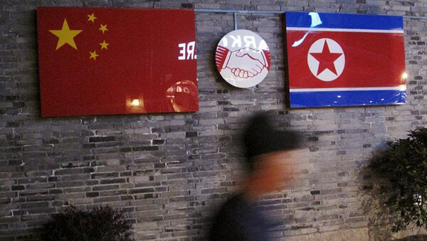Chinese and  North Korean national flags (File) - Sputnik International