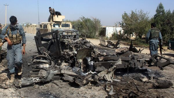 Afghan security forces inspect the site of a U.S. airstrike in Kunduz city, north of Kabul, Afghanistan (File) - Sputnik International
