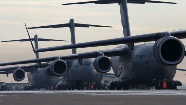 U.S. Air Force C-17 Globemaster III's sit stacked up on ramp 5 ready for the days mission, Ramstein Air Base, Germany - Sputnik International
