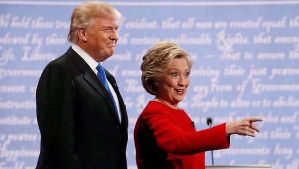Republican US presidential nominee Donald Trump and Democratic U.S. presidential nominee Hillary Clinton look on at the start of their first presidential debate at Hofstra University in Hempstead, New York, US, September 26, 2016. - Sputnik International