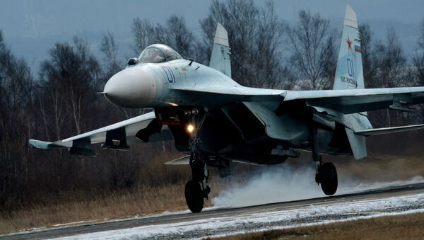 Su-27SM fighter lands as part of the tactical flight drill by fighter aircraft of the Eastern Military District conducted at Tsentralnaya Uglovaya military airfield in Primorye Territory - Sputnik International