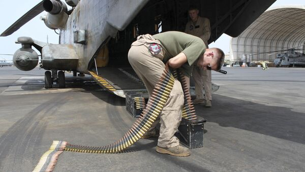 In this photo taken May 26, 2010, Sgt. Tyler Johnson, 23, of Portland, Ore., loads ammunition cans for a .50 caliber machine gun mounted on the back of a Marine CH53 at Camp Lemonnier, Djibouti, the only U.S. base in Africa - Sputnik International