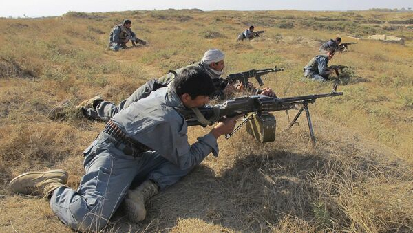 Afghan National Army soldiers take positions during a joint operation by ISAF and ANSF against taliban in Kunduz province, north of Kabul, Afghanistan (File) - Sputnik International