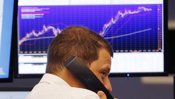 A trader makes a telephone call at the stock market in Frankfurt, Germany (File) - Sputnik International