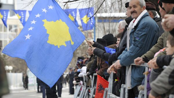Kosovo Albanians wave the Kosovo flag during a celebration marking the 4th anniversary of the Kosovo's declaration of independence in Pristina on February 17, 2012 - Sputnik International