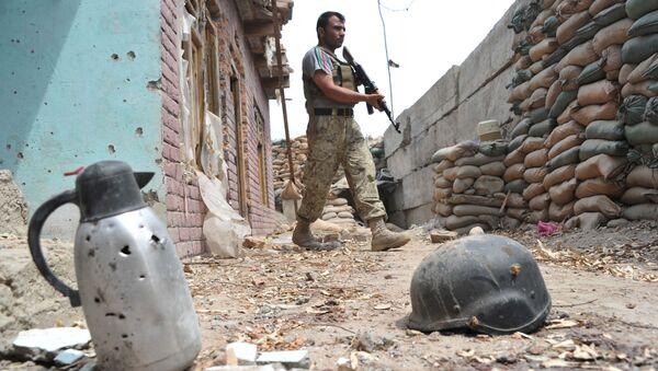 An Afghan security serviceman keep watch at a damaged police post following an airstrike in Bati Kot district in Nangarhar province (File) - Sputnik International