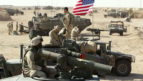 American marines of the USMC (US Marine Corps) put a flag on a antenna of a HMMWI (Hight Mobility Multi Wheeled Vehicles) in the north of the desert Kuwait near the Iraqi border 15 March 2003 - Sputnik International