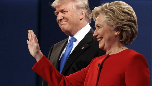 Republican presidential candidate Donald Trump, left, stands with Democratic presidential candidate Hillary Clinton at the first presidential debate at Hofstra University, Monday, Sept. 26, 2016, in Hempstead, N.Y. - Sputnik International
