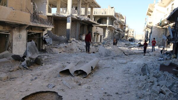People inspect a damaged site after airstrikes on the rebel held Sheikh Fares neighbourhood of Aleppo, Syria October 1, 2016 - Sputnik International