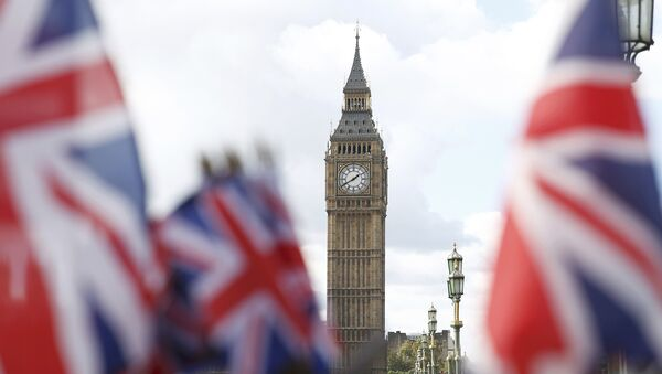 Union flags on sale at a souvenir stall fly in the breeze opposite the Houses of Parliament in London, Britain - Sputnik International