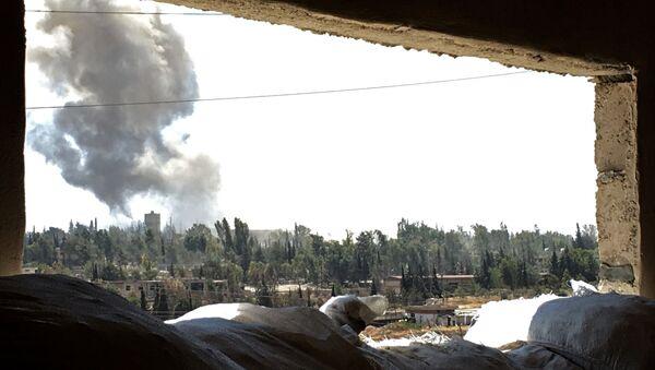 Smoke over Ramuse district of southern Aleppo. (File) - Sputnik International