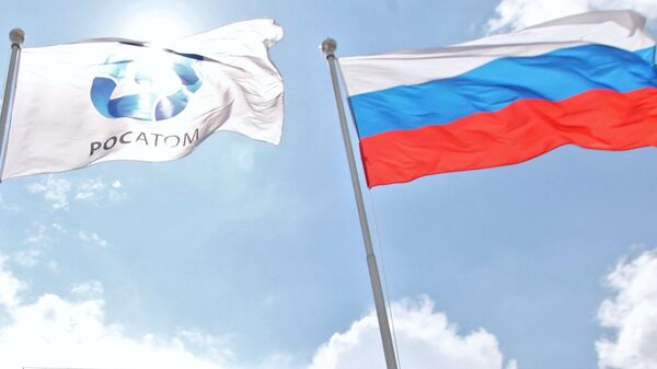 Russian and Rosatom State Corporation flags. (File) - Sputnik International