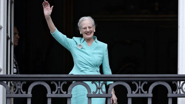 The Queen of Denmark, Margrethe II celebrates her 75th birthday on the balcony looking out at the crowd below, at Christian VII's Palace, Amalienborg, Thursday, April 16 2015. - Sputnik International