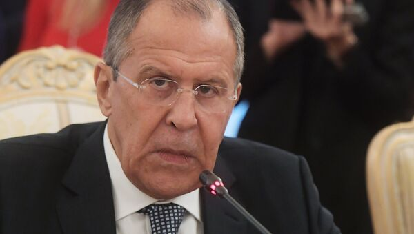 Russian Foreign Minister Sergei Lavrov in Moscow at a meeting with French Foreign Affairs and International Development Minister Jean-Marc Ayrault. - Sputnik International
