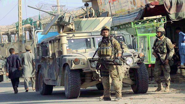 Afghan security forces keep watch in front of their armoured vehicle in Kunduz city, Afghanistan October 4, 2016 - Sputnik International