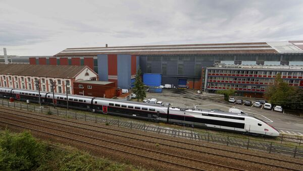 A new French high-speed train TGV is seen in front of the main plant of the French engineering giant Alstom in Belfort, France, September 16, 2016 - Sputnik International