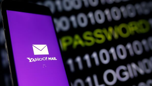 Yahoo Mail logo is displayed on a smartphone's screen in front of a code in this illustration taken in October 6, 2016. - Sputnik International