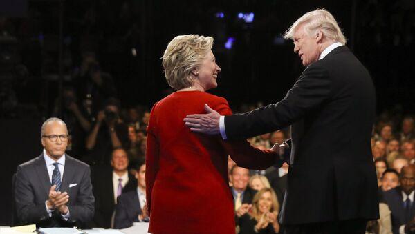 In this Sept. 26, 2016 file photo, Democratic presidential nominee Hillary Clinton and Republican presidential nominee Donald Trump shake hands during the presidential debate at Hofstra University in Hempstead, N.Y. - Sputnik International