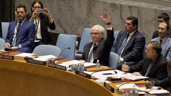 Russian ambassador to the United Nations Vitaly Churkin vetoes a Security Council vote on a French-Spanish resolution on Syria at the UN headquarters, October 8, 2016, in New York City - Sputnik International
