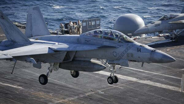 A U.S. Navy F/A-18 Super Hornet fighter lands onto the deck of the USS Ronald Reagan, a Nimitz-class nuclear-powered super carrier, during a joint naval drill between South Korea and the U.S. (File) - Sputnik International