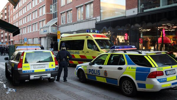 Policemen and ambulance workers stand in front of the entrance of a building in Storgatan in central Malmo (File) - Sputnik International