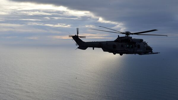 This picture taken on February 24, 2016, shows a French Caracal helicopter flying offshore during an air-to-air refuelling exercise. - Sputnik International