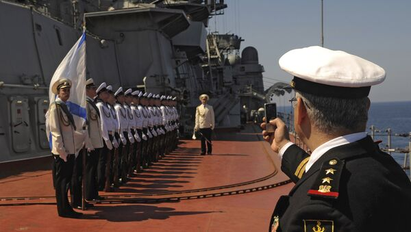 Russia's nuclear-powered missile cruiser Pyotr Veliky navy sailors attend a greeting ceremony for the Russian official delegation at Syria's Mediterranean port of Tartus.File photo - Sputnik International